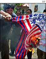 Protesters burning US flag