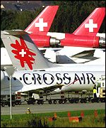 A Crossair plane passes Swissair craft