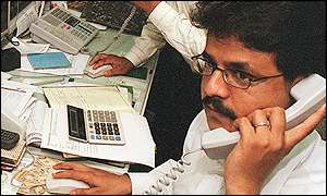 A stock trader in Karachi, Pakistan's main financial centre