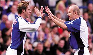 Garry Flitcroft (l) celebrates his goal with Henning Berg