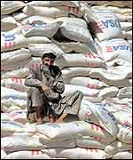Afghan aid worker with food aid
