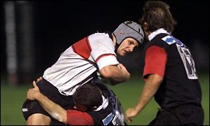Simon Taylor is halted by a Biarritz tackle