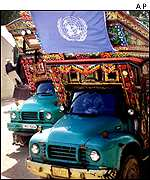 Local trucks delivering UN aid