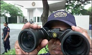 US Defense Systems security guards do surveillance around the US embassy in Bangkok