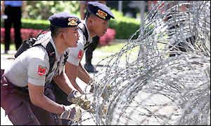 Police erect barbed-wire barricades to protect the US embassy in Jakarta