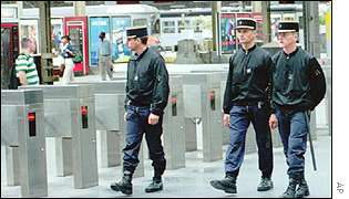 French police patrol rail station