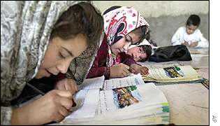 Afghan refugee children in a makeshift school in Iran