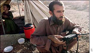 Afghan refugee listening to radio AP