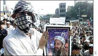 Protester in Pakistan with picture of Osama Bin Laden