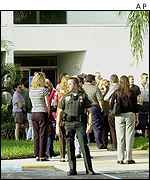 People queue at the Health Department in Delray Beach, Florida