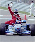 Jean Alesi hitches a ride with Michael Schumacher after his 1995 Canadian GP win