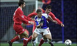 Blackburn's Mark Hughes is challenged by Mark Wilson
