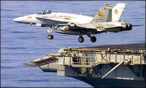 An F-18 takes off from the USS Enterprise