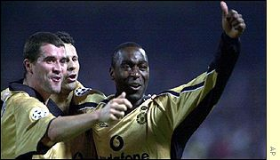Andy Cole celebrates his goal against Olympiakos