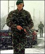 A 42 Commando marine on patrol in a blizzard in Crossmaglen, South Armagh