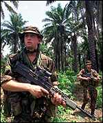 A 42 Commando patrols makes its way through the Sierra Leone jungle