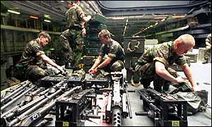 Royal Marines from 42 Commando S Machine Group check their equipment on HMS Ocean