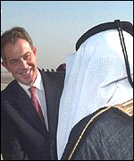 UK Prime Minister Tony Blair greeted by unidentified official on arrival in Oman
