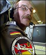 German crewman aboard Awacs as it leaves Germany's Geilenkirchen air base, 10 October