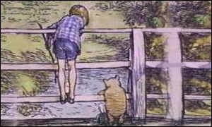 Christopher Robin and Pooh play pooh sticks