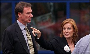 Phil Thompson leaves hospital with Houllier's wife, Isabel