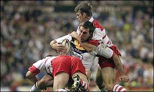 Daniel Garner is tackled by Wigans Gary Connolly and Terry Newton