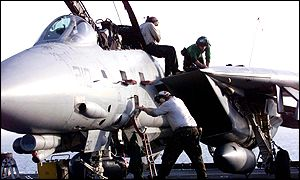 US F-14 fighter jet is prepared for take-off from USS Enterprise aircraft carrier