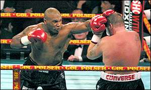 Mike Tyson throws some clubbing blows at Brian Nielsen