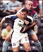 Paolo Di Canio hitches a ride on Lucas Neill