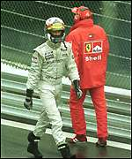 [ image: Coulthard walks back after the mass pile-up]
