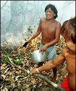 [ image: Yanomami Indians tackle fire in March]