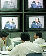 [ image: Malaysia traders watch the events unfold]