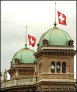[ image: Flags at half mast at the Swiss Federal Parliament in Bern]