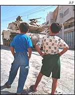 An Israeli tank leaves Hebron