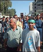 Protesters marching in Gaza