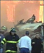 Fire-fighters work at the scene of the American Airlines Flight 587