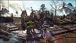 New York City fire-fighters work at the scene of the crash of American Airlines flight 587