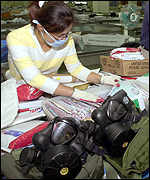 Gas masks and gloves are available for postal workers in South Korea