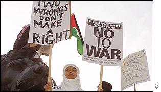 Anti-war posters held-up at a protest rally in London
