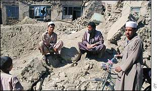 Residents in Kabul survey the damage after a US strike
