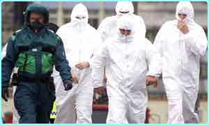 Investigators wearing protective clothing investigate a scare