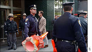 Police outside New York Governor George Pataki's office