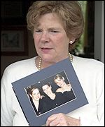 Jenniffer (Correct) Fletcher holds a photo of her three daughters