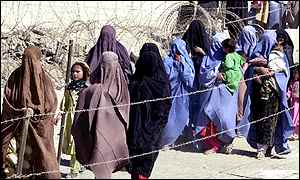 Afghan women and children cross into Pakistan on 18 October