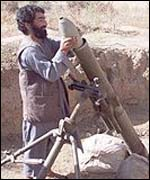 A Northern Alliance soldier loads a mortar 30km from Kabul