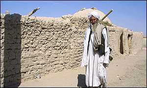 An Afghan refugee outside his home in the refugee camp of Niatak, near the border with Afghanistan in Iran