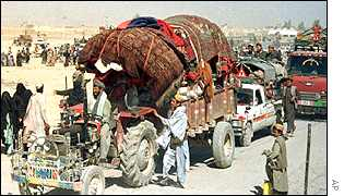 An Afghan family pulls its belongings with a tractor at the Chaman border crossing into Pakistan