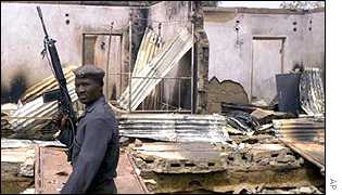 Soldier in destroyed house