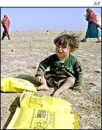 Afghan child with aid package