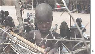 Sudanese child waits to be fed by UN aid-workers, 1998